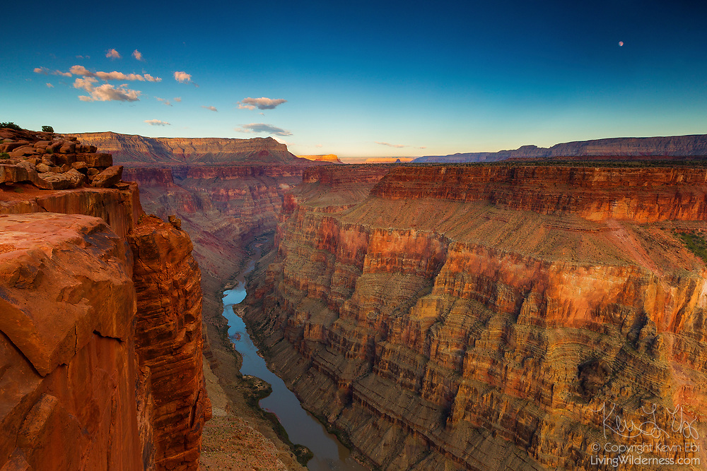 The full moon rises over the Grand Canyon and Colorado River in this view from the Tuweep Overlook (also spelled Toroweap) in Grand Canyon National Park, Arizona.  The Tuweep Overlook, located on the north rim of the Grand Canyon, provides one of the most dramatic canyon views. Here, the canyon is 3,000 feet deep and one mile wide — one of the few places on the Grand Canyon rim where you can see both the Colorado River and the other side of the canyon.