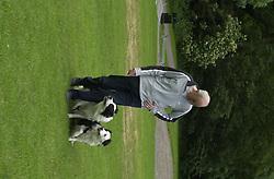 Eddie Sander with his Dogs Jackson and Inka<br /><br />18 June 2004<br /><br />Copyright Paul David Drabble<br /> [#Beginning of Shooting Data Section]<br />Nikon D1 <br /> Focal Length: 80mm<br /> Optimize Image: <br /> Color Mode: <br /> Noise Reduction: <br /> 2004/06/18 09:40:08.0<br /> Exposure Mode: Manual<br /> White Balance: Auto<br /> Tone Comp: Normal<br /> JPEG (8-bit) Fine<br /> Metering Mode: Center-Weighted<br /> AF Mode: AF-S<br /> Hue Adjustment: <br /> Image Size:  2000 x 1312<br /> 1/200 sec - F/7.1<br /> Flash Sync Mode: Not Attached<br /> Saturation: <br /> Color<br /> Exposure Comp.: 0 EV<br /> Sharpening: Normal<br /> Lens: 80-200mm F/2.8<br /> Sensitivity: ISO 200<br /> Image Comment: <br /> [#End of Shooting Data Section]