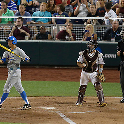 Jun 24, 2013; Omaha, NE, USA; UCLA Bruins shortstop Pat Valaika (10) reacts after striking out to end the seventh inning in game 1 of the College World Series finals as Mississippi State Bulldogs catcher Nick Ammirati (center) celebrates at TD Ameritrade Park. Mandatory Credit: Derick E. Hingle-USA TODAY Sports