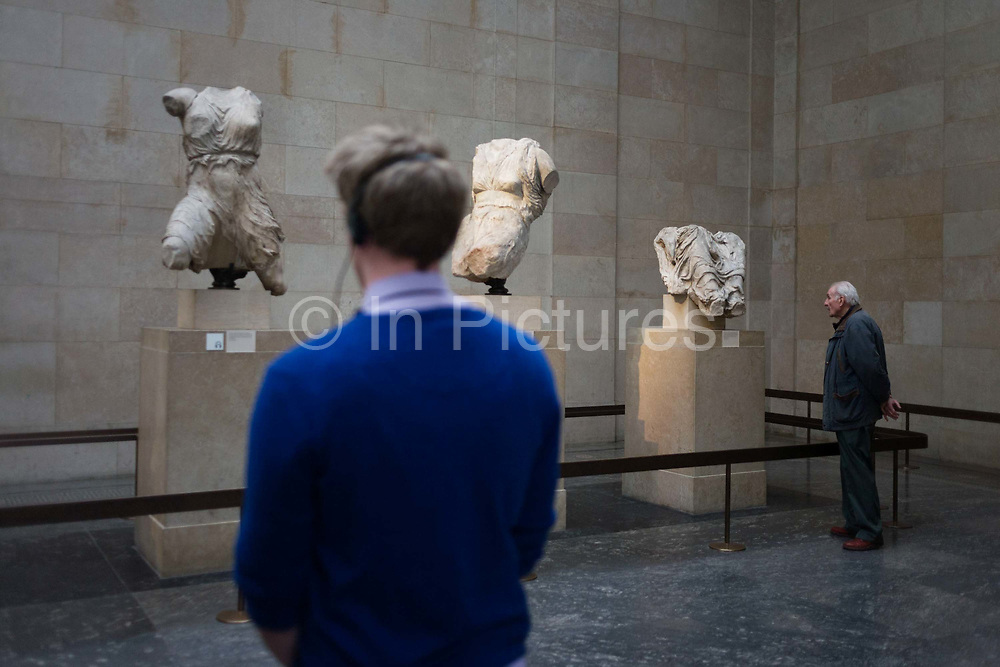 Visitors in London's British Museum admire the Ancient Greek Parthenon Metopes also knows as the Elgin Marbles. 92 Metopes were rectangular slabs placed over the columns of the Athens Parthenon temple depicting scenes from Greek mythology. The Elgin Marbles are a collection of classical Greek marble sculptures (mostly by Phidias and his pupils), inscriptions and architectural members that originally were part of the Parthenon and other buildings on the Acropolis of Athens. Thomas Bruce, 7th Earl of Elgin, the British ambassador to the Ottoman Empire from 1799–1803, obtained a controversial permit from the Ottoman authorities to remove pieces from the Acropolis. From 1801 to 1812 Elgin's agents removed about half of the surviving sculptures of the Parthenon