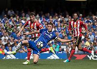Football - 2016 / 2017 Premier League - Chelsea vs. Sunderland <br /> <br /> Gary Cahill of Chelsea clears infront of Fabio Borini of Sunderland at Stamford Bridge.<br /> <br /> COLORSPORT/DANIEL BEARHAM