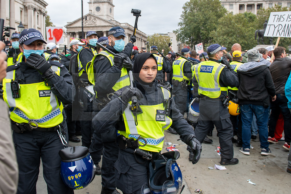 © Licensed to London News Pictures. 26/09/2020. London, UK. Metropolitan Police officer Constable Ruby Begum faces an investigation after racist tweets were uncovered, she is shown here confronting protesters at an anti-lockdown demonstration at Trafalgar Square in September 2020. Photo credit: Peter Manning/LNP