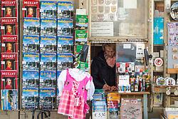 20.03.2014, Salzburg, AUT, Stadtansicht Salzburg, im Bild Eine Verkaeuferin, ihrem Souvenir-Geschaeft fuer Touristen // Cityscape of Salzburg, Austria on 2014/03/20. EXPA Pictures © 2014, PhotoCredit: EXPA/ Freshfocus/ Andy Mueller<br /> <br /> *****ATTENTION - for AUT, SLO, CRO, SRB, BIH, MAZ only*****