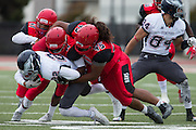 Community College of San Francisco defensive end Jonathan Pohahau (45) leads a tackle on College of Siskiyous defensive back Daevon Guildford (22) at Community College of San Francisco in San Francisco, Calif., on September 10, 2016. (Stan Olszewski/Special to S.F. Examiner)