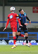 Wigan Athletic forward Will Keane(10) obscured by the ball and Ollie Rathbone of Rochdale (14)  jump for a header during the EFL Sky Bet League 1 match between Rochdale and Wigan Athletic at the Crown Oil Arena, Rochdale, England on 16 January 2021.