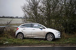 © Licensed to London News Pictures. 04/12/2020. Windsor Green, UK. A car which has come off the road in icy conditions near Windsor Green, Suffolk as the south of England experiences snowfall for the first time this winter. Photo credit: Ben Cawthra/LNP
