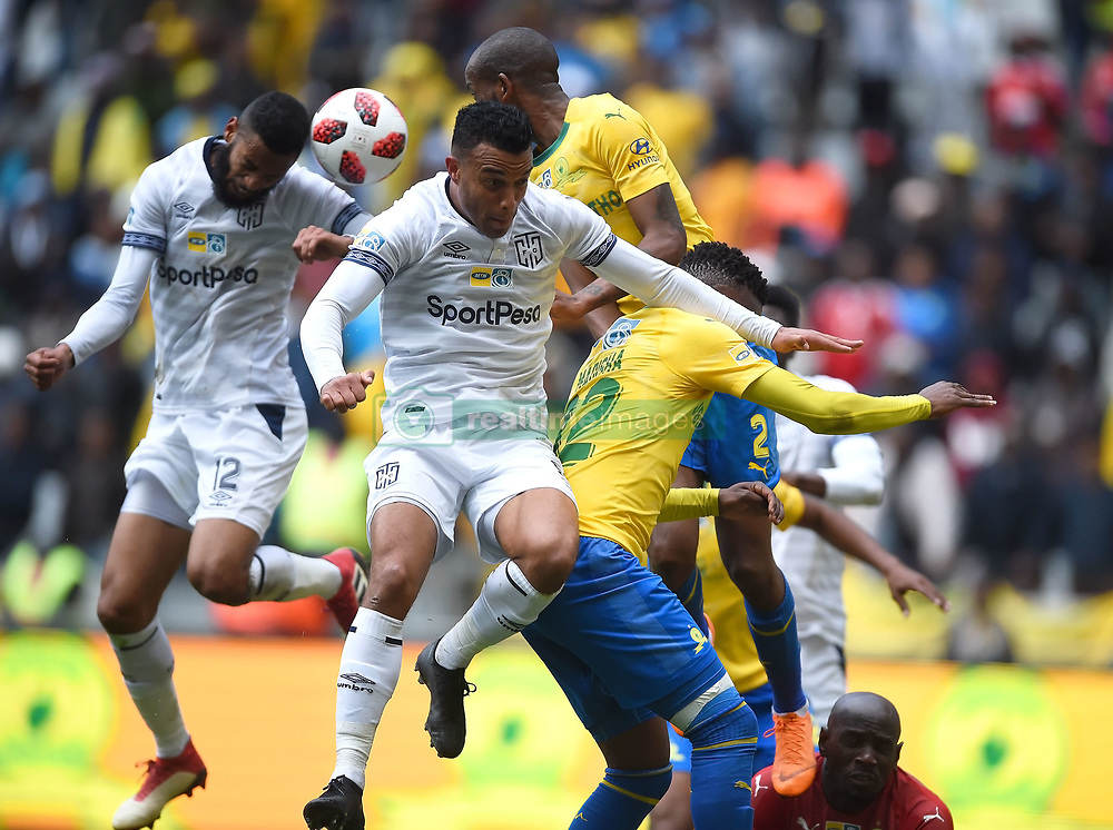Cape Town-180825- Cape Town City striker Matthew Rusike challenged by Mamelodi Sundowns defender Mosa Lebusa  in the MTN 8 semi-final at Cape Town Stadum.Photographer :Phando Jikelo/African News Agency/ANA