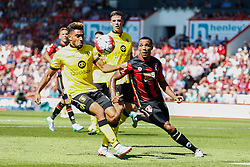 Jordan Amavi of Aston Villa clears the ball under pressure from Callum Wilson of AFC Bournemouth - Mandatory by-line: Jason Brown/JMP - Mobile 07966 386802 08/08/2015 - FOOTBALL - Bournemouth, Vitality Stadium - AFC Bournemouth v Aston Villa - Barclays Premier League - Season opener