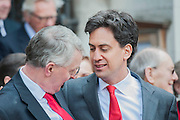 Ed Miliband hugs Hilary benn afterwards. Tony Benn's funeral at 11.00am at St Margaret's Church, Westminster. His body was brought in a hearse from the main gates of New Palace Yard at 10.45am, and was followed by members of his family on foot. The rout was lined by admirers. On arrival at the gates it was carried into the church by members of the family. Thursday 27th March 2014, London, UK. Guy Bell, 07771 786236, guy@gbphotos.com
