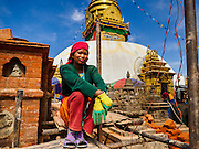 04 MARCH 2017 - KATHMANDU, NEPAL: A construction worker rests while rebuilding a shrine at Swayambhu Stupa. The stupa was badly damaged in the 2015 Nepal earthquake. Recovery seems to have barely begun nearly two years after the earthquake of 25 April 2015 that devastated Nepal. In some villages in the Kathmandu valley workers are working by hand to remove ruble and dig out destroyed buildings. About 9,000 people were killed and another 22,000 injured by the earthquake. The epicenter of the earthquake was east of the Gorka district.     PHOTO BY JACK KURTZ
