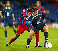 Fotball<br /> Caling Cup England 2004/2005<br /> Andre runde<br /> 21.09.2004<br /> Foto: SBI/Digitalsport<br /> NORWAY ONLY<br /> <br /> Crystal Palace v Hartlepool<br /> <br /> Darren Powell  of Crystal Palace clashes with Joel Porter of Hartlepool