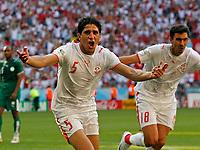 Photo: Glyn Thomas.<br />Tunisia v Saudi Arabia. Group H, FIFA World Cup 2006. 14/06/2006.<br /> Zied Jaziri (L) celebrates opening the scoring for Tunisia.