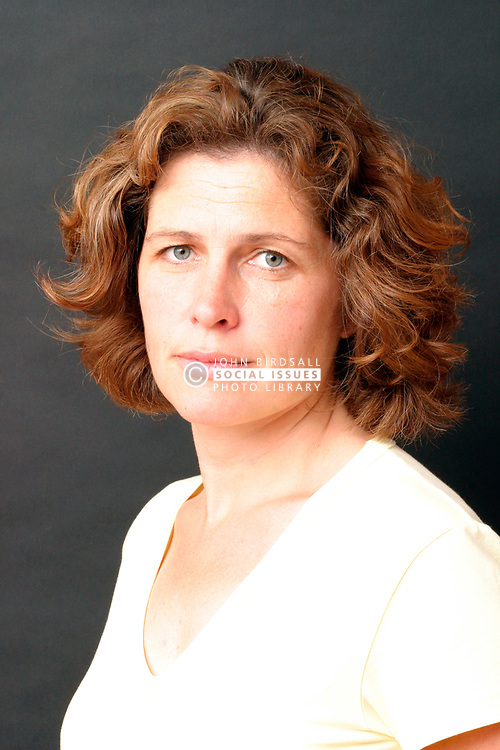 Portrait of woman aged 40 looking serious UK