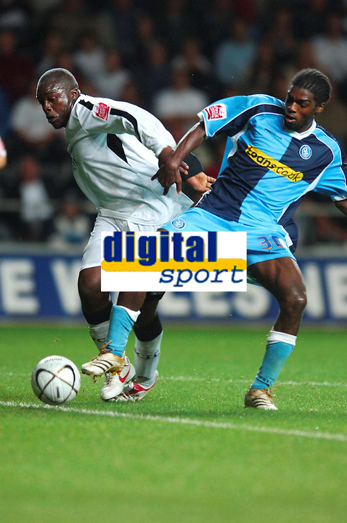 Photo: Adam Davies.<br />Swansea City v Wycombe Wanderers. Carling Cup. <br />22/08/2006.<br />Wycombe's Anthony Grant and Swansea's Adebayo Akinfenwa (L) battle.