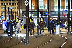 © Licensed to London News Pictures . 09/08/2011 . Manchester , UK . Mounted police in Piccadilly , as disorder spreads to Manchester during a 4th night of rioting and looting , following a protest against the police shooting of Mark Duggan in Tottenham . Photo credit : Joel Goodman/LNP
