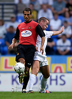 Photo. Jed Wee<br /> Bolton Wanderers v Mallorca, Pre-season Friendly, Reebok Stadium, Bolton. 06/08/2003.<br /> Mallorca's Marcos (L) offloads the ball as Bolton's Kevin Nolan comes clattering in.