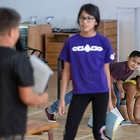 """Kaden Watson, 10, and Veronica Rodriguez, 11, peer over at Makayah Crowfoot, 12, while rehearsing a scene from  Shakespeare's """"Taming of the Shrew,"""" Tuesday, June 11 at the Children's Theater Camp."""