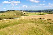 View of Pewsey Vale along chalk scarp slope from Adam's Grave, Alton Barnes, Wiltshire, England, UK