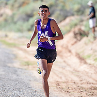 Ty McCray from Miyamura High School comes in first place for boys varsity cross country at the Curtis Williams Invitational, Saturday Oct. 6, 2018 at Red Rock Park in Church Rock.
