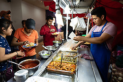 Mexico City, Mexico, 26 March 2020, locals in Mexico City continue to eat street food despite recommendations to stay at home and maintain a social distance of 1.5 meters.