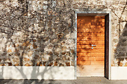 Architecture, wooden door of a stone house, exterior
