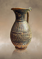 580 - 560 B.C olpai style jug made by the Etrusco-Corinthian Group of Palmette Fenicie, inv 71019,   National Archaeological Museum Florence, Italy .<br /> <br /> If you prefer to buy from our ALAMY PHOTO LIBRARY  Collection visit : https://www.alamy.com/portfolio/paul-williams-funkystock - Scroll down and type - Etruscan Florence - into LOWER search box. (TIP - Refine search by adding a background colour as well).<br /> <br /> Visit our ETRUSCAN PHOTO COLLECTIONS for more photos to download or buy as wall art prints https://funkystock.photoshelter.com/gallery-collection/Pictures-Images-of-Etruscan-Historic-Sites-Art-Artefacts-Antiquities/C0000GgxRXWVMLyc