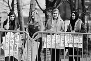 01212018 - Knoxville, Tennessee, USA: A group of women react as members of the Traditionalist Workers Party, a neo-Nazi white nationalist group, shout slogans in protest of the Women's March, Sunday, January 21, 2018 in Knoxville, Tenn.
