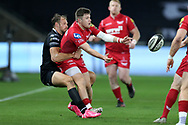 Steffan Evans of the Scarlets is tackled by Cory Allen of the Ospreys. Guinness Pro14 rugby match, Ospreys v Scarlets at the Liberty Stadium in Swansea, South Wales on Saturday 7th October 2017.<br /> pic by Andrew Orchard, Andrew Orchard sports photography.