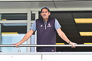 Somerset head coach Jason Kerr looks out from the team balcony after a heavy rain shower delayed the start of play during the Specsavers County Champ Div 1 match between Somerset County Cricket Club and Essex County Cricket Club at the Cooper Associates County Ground, Taunton, United Kingdom on 26 September 2019.