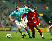 Liverpool's Salid Diao and Sunderland's George McCartney during the Premiership match at Anfield, Liverpool, Sunday, November 17th, 2002. <br /><br />Pic by David Rawcliffe/Propaganda<br /><br />Any problems call David Rawcliffe on +44(0)7973 14 2020 or email david@propaganda-photo.com - http://www.propaganda-photo.com