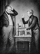 Michael Faraday (1791-1867) English chemist and physicist, left, and John Frederic Daniell (1790-1845) English chemist, physicist and meteorologist. Among his inventions were the Daniell cell, a wet storage battery, and a hygrometer. Engraving from Circa 1840