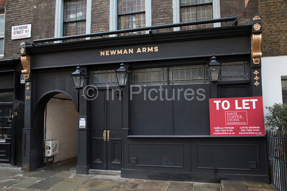 The Newman Arms closed down pub in London, England, United Kingdom. Due to the economic downturn many pubs like this one are now boarded up. Other factors in the demise of some pubs are increased rental rates, lower disposable income and the smoking ban, while the trend towards wine drinking, and competition from off-licences and supermarkets has also hit pubs, especially those who concentrate on beer sales.