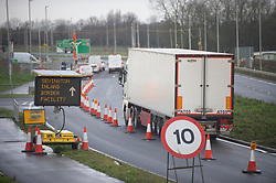 © Licensed to London News Pictures 06/01/2021.         Ashford, UK. Traffic on the A2070 outside the site. The Sevington Inland Border Facility in Ashford, Kent has opened its gates to freight traffic heading to Europe. Lorry drivers are receiving Covid-19 tests on part of the site while workmen continue to complete the 66 acre plot which will hold 1700 trucks when finished. Photo credit:Grant Falvey/LNP