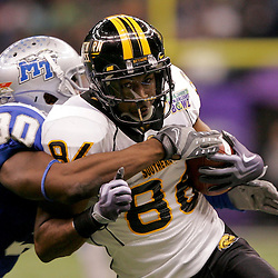 Dec 20, 2009; New Orleans, LA, USA; Southern Miss Golden Eagles wide receiver Peter Wilkes (86) is tackled by Middle Tennessee State Blue Raiders linebacker Cam Robinson (30) during the first half of the 2009 New Orleans Bowl at the Louisiana Superdome.  Mandatory Credit: Derick E. Hingle-US PRESSWIRE