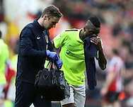Gabriel Zakuani of Northampton gets treatment on a bloody nose during the English League One match at Bramall Lane Stadium, Sheffield. Picture date: December 31st, 2016. Pic Simon Bellis/Sportimage