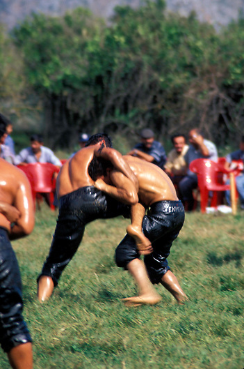 Young oiled wrestlers grapple with each other during a traditional wrestling tournament in Finike in Southern Turkey off the Turquoise Coast