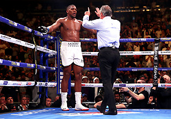 Referee Mike Griffin (right) counts Anthony Joshua down at Madison Square Garden, New York.