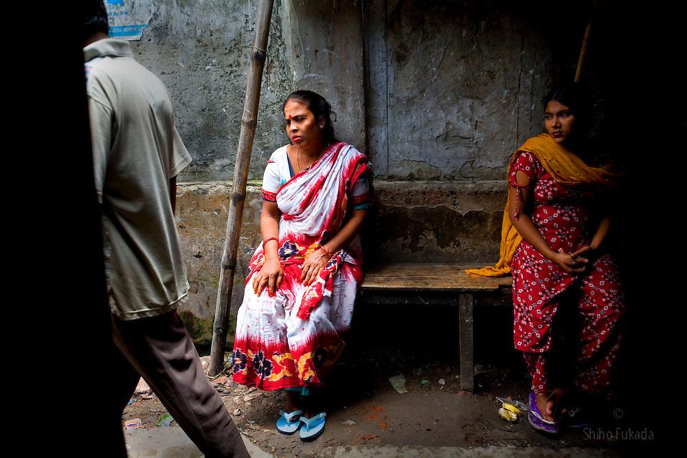 Aging sex worker Josna, 60, waits for a cutomer at brothel in Faridpur, Bangladesh.