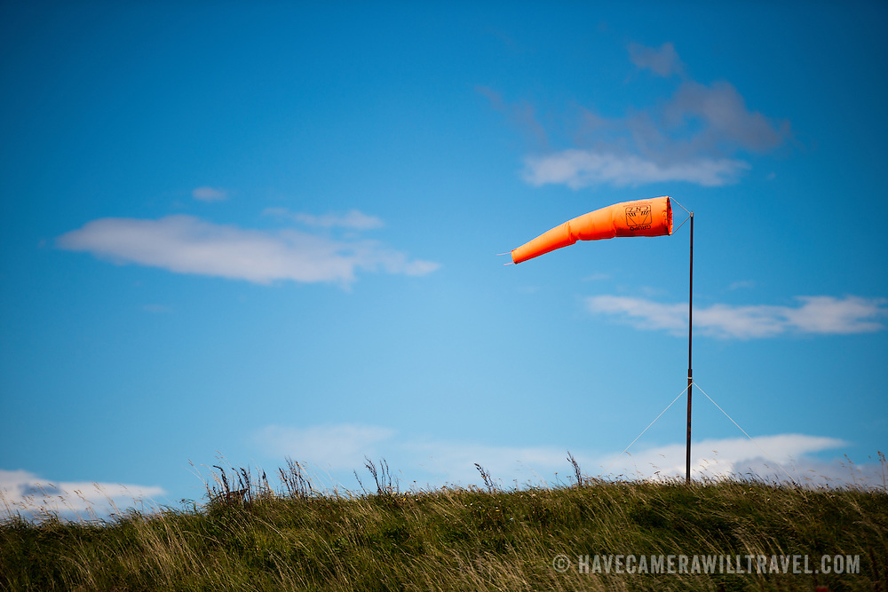 A windsock blows in strong wind at Ushuaia Airport, Argentina.