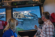 """Jungfraujoch """"Top of Europe"""" is the highest railway station in Europe (3454 meters elevation). Here, visitors can admire a high-Alpine wonderland from platforms atop the Aletsch Glacier or carved inside, in the Ice Palace. Jungfraujoch is a col at 3466 m between the peaks of Jungfrau and Mönch in the Bernese Alps, on the boundary between the cantons of Bern and Valais, halfway between Interlaken and Fiesch, in Switzerland, Europe. Engineering this dramatic cog-wheel railway required 16 years (1898-1912) to carve through the Eiger and Mönch for 7 kilometers (4.3 mi), with gradients of up to 25%. Kleine Scheidegg entry station can be reached by trains from Grindelwald and Lauterbrunnen. The ride from Kleine Scheidegg to Jungfraujoch takes 50 minutes including stops at Eigerwand and Eismeer viewing portals. Downhill return takes just 35 minutes. Jungfraujoch hosts an important station of Global Atmosphere Watch (GAW), plus the Sphinx Observatory for astronomy at 3571 meters or 11,716 feet. The Swiss Alps Jungfrau-Aletsch region is honored as a UNESCO World Heritage Site. For licensing options, please inquire."""
