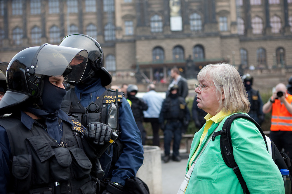 Protestor and special forces of the Czech police during a demonstration against the planned US military radar base in Czech Republic at Wenceslav square on the day of Barack Obamas participation on the EU-US summit in Prague.
