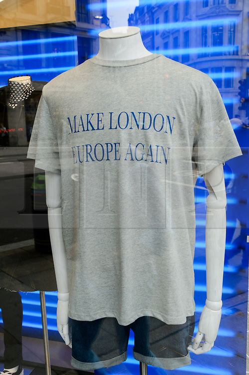 """© Licensed to London News Pictures. 18/08/2017. London, UK. t-shirt with the printed message """"Make London Europe Again"""".  A different printed message will be on sale every week at the opening of H&M group's first Weekday clothing store in Regent Street. Weekday is know for its offerings and minimalist styles, with 27 stores throughout Europe. The store is next to the H&M Arket lifestyle store. Photo credit: Ray Tang/LNP"""