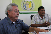 Oscar Alonzo (left), Chief Executive Officer for the Belize Sugar Cane Farmers Association (BSCFA), speaks during a management meeting as Alfredo Ortega, Chairman of the Management Committee, listens in the background. Belize Sugar Cane Farmers Association (BSCFA), Corozal, Belize. January 21, 2013.