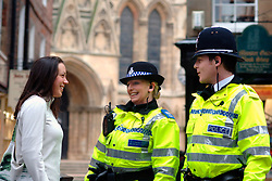 Policeman and Community Support Officer talking to young woman York; UK