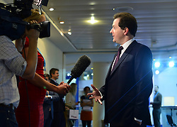 © Licensed to London News Pictures. 08/10/2012. Birmingham, UK Chancellor of the Exchequer George Osborne gives a television interview on the day of his keynote conference speech at The Conservative Party Conference at the ICC today 8th October 2012. Photo credit : Stephen Simpson/LNP