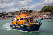 The Royal National Lifeboat Institution RNLI Dover Life boat 17-09 arriving into Folkestone Harbour, Folkestone, Kent. UK..