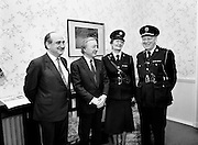 Phyllis Nolan, the first female Garda to reach the rank of Superintendent, pays a courtesy call to An Taoiseach Charles Haughey TD. She is pictured here with Gerry Collins TD, Minister for Justice, An Taoiseach Charles Haughey TD and Garda Commissioner Eugene Crowley, at the office of An Taoiseach in Government Buildings.<br /> 21 February 1989