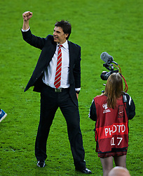 CARDIFF, WALES - Tuesday, October 13, 2015: Wales' manager Chris Coleman celebrates on the pitch after qualifying for the finals following a 2-0 victory over Andorra during the UEFA Euro 2016 qualifying Group B match at the Cardiff City Stadium. Holly Williams. (Pic by Paul Currie/Propaganda)