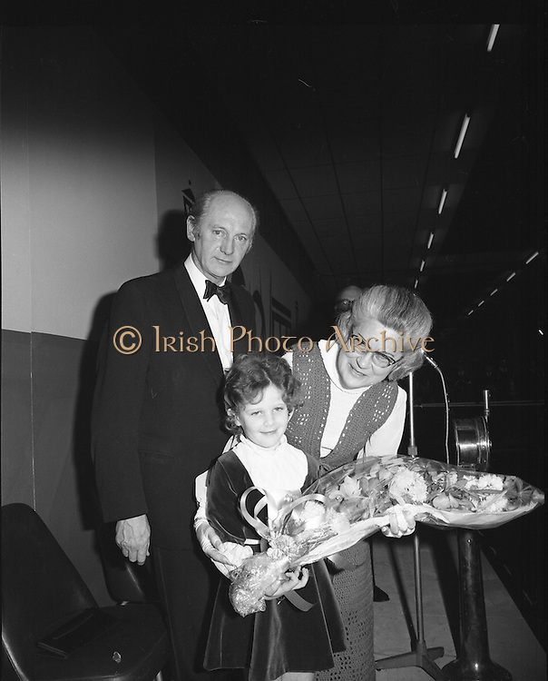 Mr Jack Lynch Opens the Boat show..1973..27.02.1973..02.27.1973..27th February 1973..After a hectic general election campaign,An Taoiseach, Jack Lynch found time before the ballot counts to officially open the Irish Boat Show in the RDS (Royal Dublin Showgrounds)...Image taken as proceedings got underway,Mrs Mairin Lynch accepted a bouquet from a young girl as Mr Jack Lynch looks on.