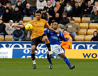 Photo: Leigh Quinnell.<br /> Wolverhampton Wanderers v Leicester City. Coca Cola Championship. 09/12/2006. Woves Lewis Gobern gets the ball ahead of Leicesters Levi Porter.